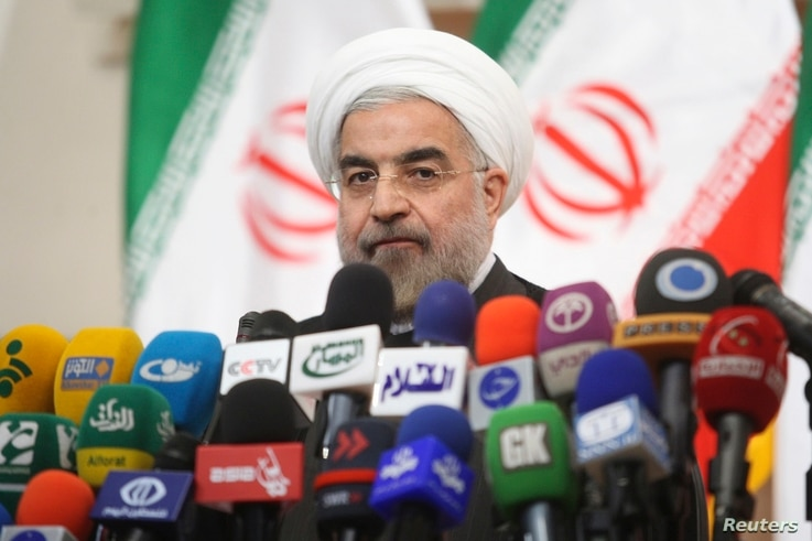 Iranian President-elect Hassan Rowhani speaks with the media during a news conference in Tehran, June 17, 2013.
