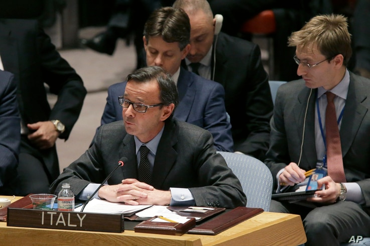 Italian Ambassador Sebastiano Cardi speaks during a Security Council meeting, Feb. 18, 2015, at United Nations headquarters.