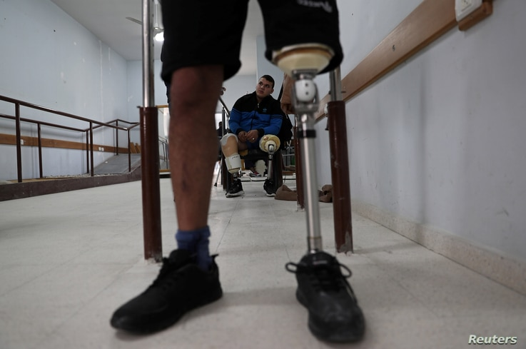 Palestinian Abdallah Qassem, 17, who, according to medics, lost both legs after he was shot by Israeli forces during a protest at the Israel-Gaza border, is seen inside an artificial limb center in Gaza City, April 2, 2019.