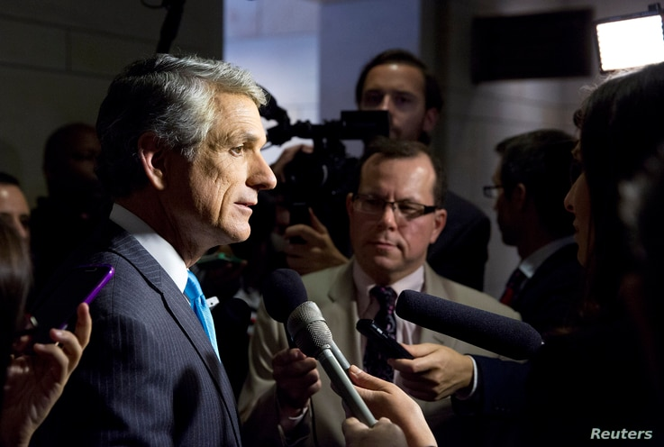 U.S. Representative Scott Rigell (R-VA) speaks to the media before attending a closed meeting for members of Congress on the situation in Syria at the U.S. Capitol in Washington Sep. 1, 2013.