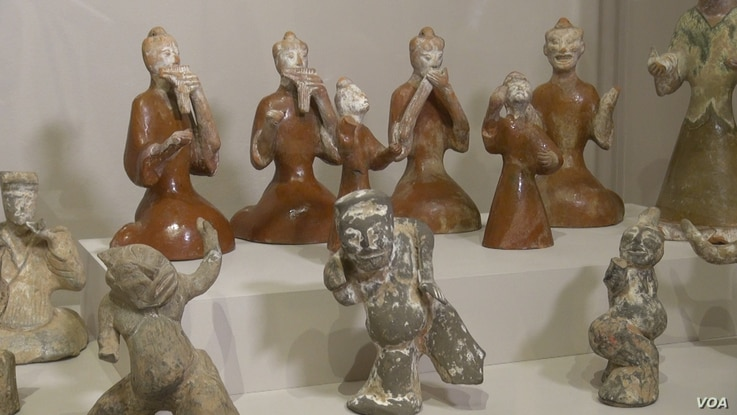 Ceramic figurines of musicians and dancers illustrate the joyful mixing of cultures during the time of the legendary Silk Road, approximately 1,990 - 2,220 years ago.