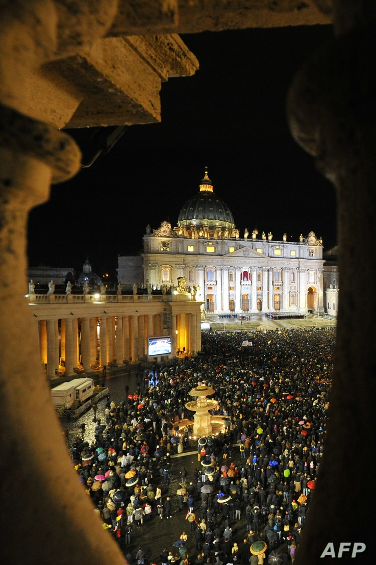 A general view shows the crowd at St Peter's Square after white smoke billowed from the chimney of the Sistine Chapel announcing that Catholic Church cardinals had elected a new pope during a conclave on March 13, 2013 at the Vatican.