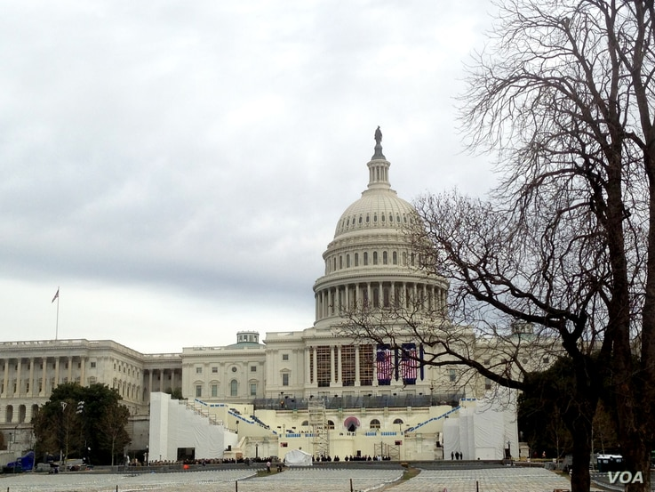 The U.S. Capitol looms over the stand for the inauguration of President-elect Donald Trump on the West Front of the Capitol in Washington, Sunday, Jan. 11, 2017. (D. Bekheet/VOA News)