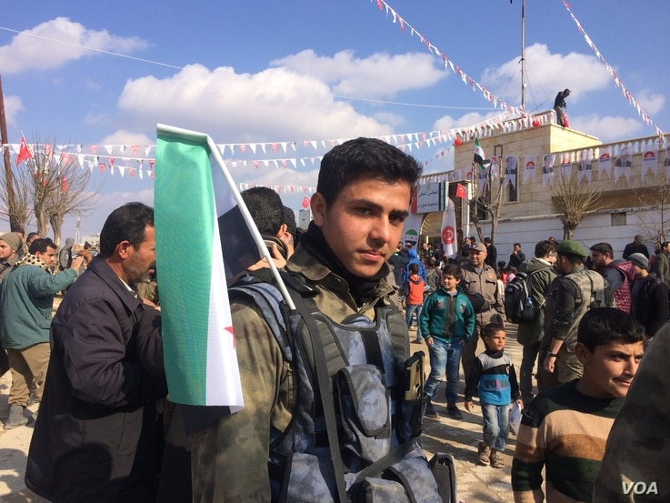 Syrian soldiers and families rally in Soran, Syria on Feb. 1, 2018. (H.Murdock/VOA)