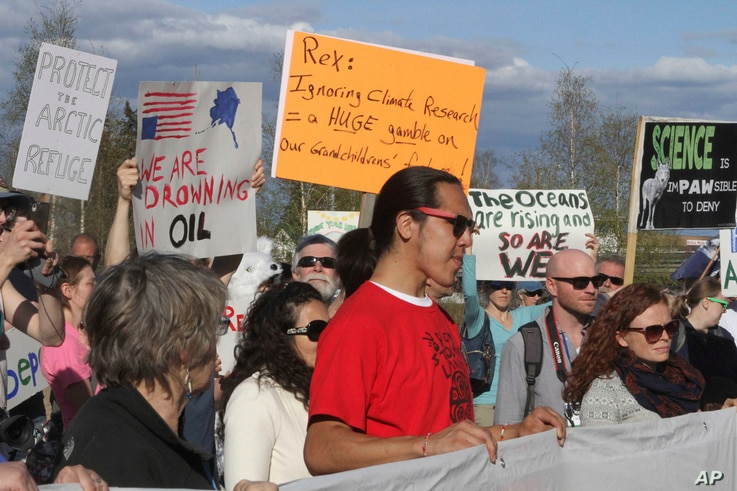 A few hundred people chanted slogans and made speeches to protest the presence of U.S. Secretary of State Rex Tillerson in Fairbanks, Alaska, May 10, 2017. High-level officials from the world's eight Arctic nations, including Tillerson, will meet in ...