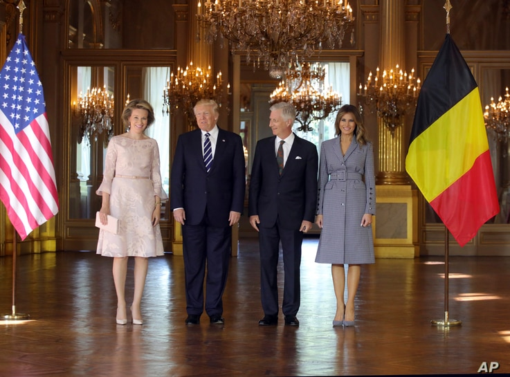 President Donald Trump, second left, and his wife Melania, right, pose with Belgium's King Philippe and his wife Queen Mathilde at the Royal Palace in Brussels, May 24, 2017.
