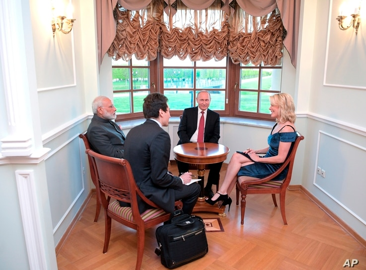 NBC journalist Megyn Kelly interviews India's Prime Minister Narendra Modi (left) and Russian President Vladimir Putin (center) in the Constantine Palace at the St. Petersburg International Economic Forum in St. Petersburg, Russia, June 1, 2017.