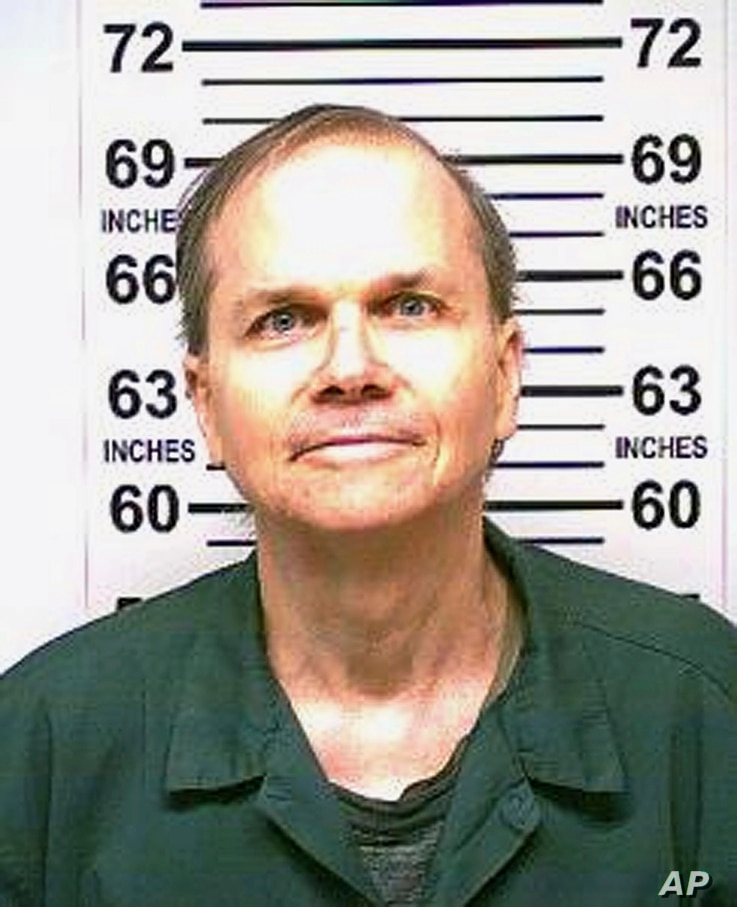 FILE - This Jan. 31, 2018 photo, provided by the New York State Department of Corrections, shows Mark David Chapman, the man who killed John Lennon.