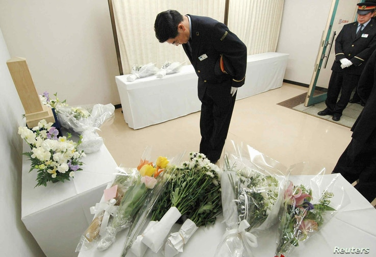 FILE - A subway worker bows deeply as he offers a prayer for the victims killed by a doomsday cult members' sarin nerve gas attack on the Tokyo subway system in 1995, at Tokyo's Kasumigaseki station, March 20, 2005.