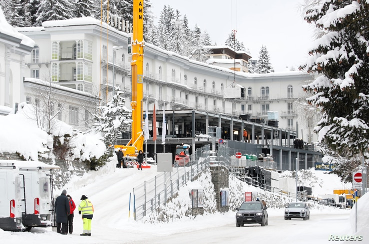 Construction workers build a temporary pavilion in front of Hotel Belvedere in Davos, Switzerland, Jan. 12, 2019.