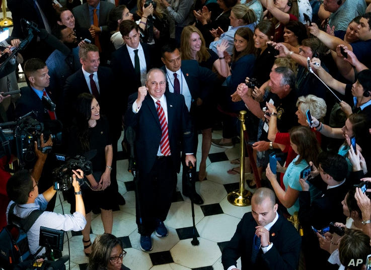 House Republican Whip Steve Scalise walks with his wife Jennifer, left, as he leaves the House chamber in the Capitol in Washington, Thursday, Sept. 28, 2017.
