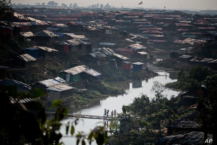 In this Thursday, Dec. 21, 2017, file photo, Rohingya Muslim children, who crossed over from Myanmar into Bangladesh, play on a bridge made by bamboos at Kutupalong refugee camp in Ukhiya, Bangladesh.