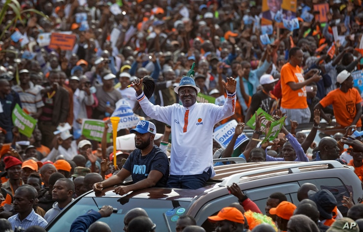 Main opposition leader Raila Odinga greets the crowd as he arrives for his final electoral campaign rally at Uhuru Park in Nairobi, Kenya, Aug. 5, 2017.