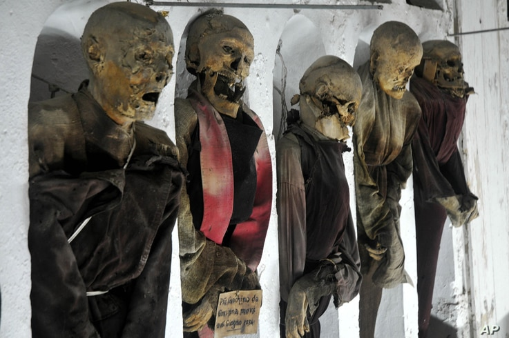 FILE - This photo taken Oct. 2, 2009, shows a view of mummified corpses in the Capuchins' Catacombs in Palermo, Sicily, southern Italy.