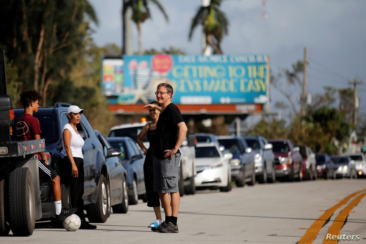 Local residents wait for the reopening of the entry road for the Florida Keys road after Hurricane Irma strikes Florida, in Homestead, Florida, Sept. 11, 2017.