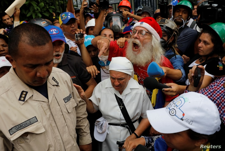 Elderly opposition supporters confront security forces while rallying against President Nicolas Maduro in Caracas, Venezuela, May 12, 2017.
