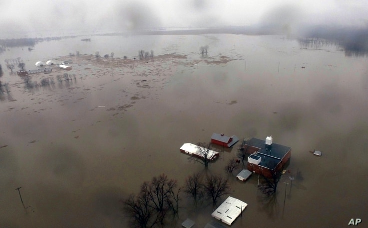 An aerial photo shows flooding along the Missouri River in Pacific Junction, Iowa, March 19, 2019.