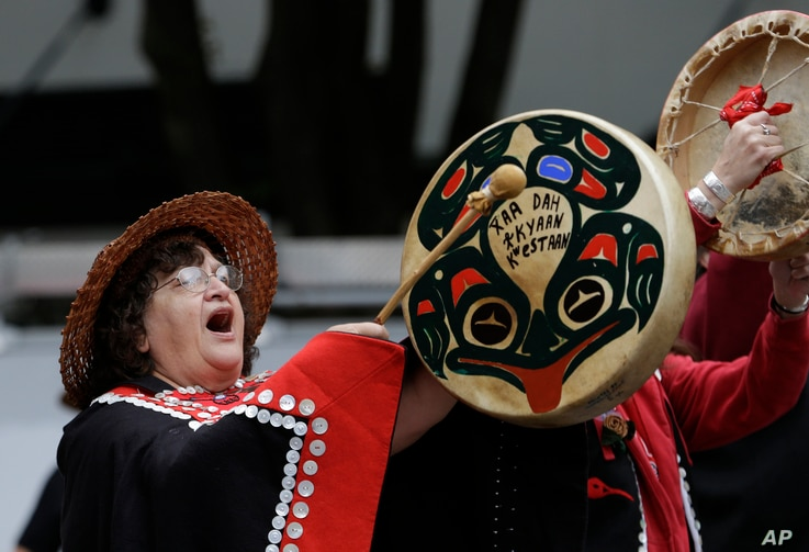 Sharon Brown, a Haida tribal member from Bonney Lake, Wash., drums during a march for Indigenous Peoples Day, Oct. 12, 2015, in Seattle. As the U.S. observes Columbus Day, it will also be Indigenous Peoples Day in some U.S. cities.
