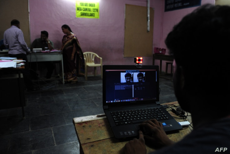 FILE - A technician checks a cctv camera before fixing in a sensitive polling booth in Chennai on May 15, 2016  in the southern Indian state of Tamil Nadu.