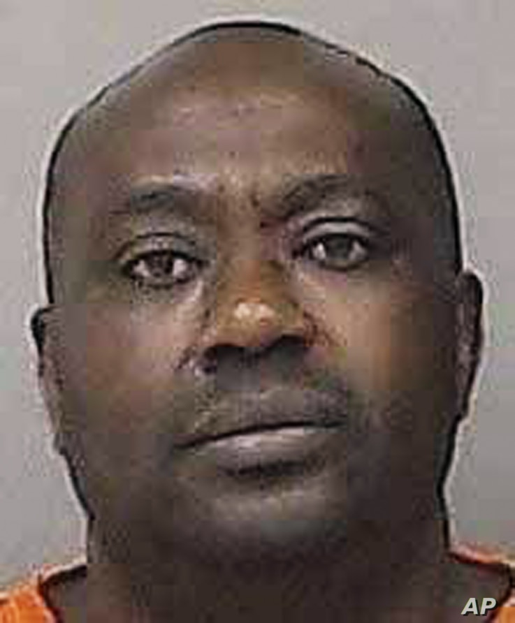 This undated photo provided by the Linn County Jail in Cedar Rapids, Iowa, shows Gervais Ngombwa. A federal judge sentenced Ngombwa March 2, 2017, for lying to gain citizenship in the U.S. after helping carry out deadly attacks during the country's...