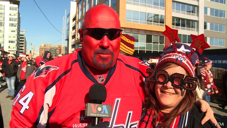 Jim Hoover and wife Lilly, Capitals fans who attended the New Year's Day Winter Classic NHL game. (VOA News/Arash Arabasadi)