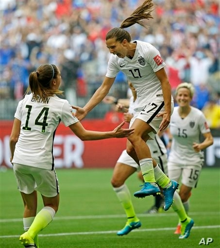 United States' Tobin Heath, center, celebrates with Morgan Brian, left, after Heath scored a goal against Japan during the second half of the FIFA Women's World Cup soccer championship in Vancouver, British Columbia, Canada, Sunday, July 5, 2015. (AP...