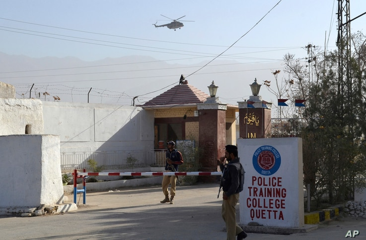 Pakistani police officers stand guard outside a police training center which was attacked by militants in Quetta, Pakistan, Oct. 25, 2016.