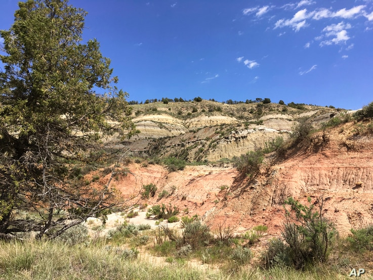 Theodore Roosevelt National Park, in western North Dakota, is known for its hills, ridges, buttes and bluffs where millions of years of erosion have exposed colorful sedimentary rock layers.