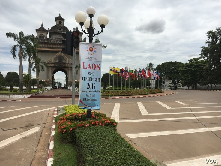 An ASEAN sign and flags at the Patuxai, a war monument known as Victory Gate. (M. A. Salinas/VOA)