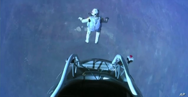 This image made from video, provided by Red Bull Stratos shows pilot Felix Baumgartner of Austria as he jumps out of the capsule during the final manned flight for Red Bull Stratos on Sunday, Oct. 14, 2012. In a giant leap from more than 24 miles up,...
