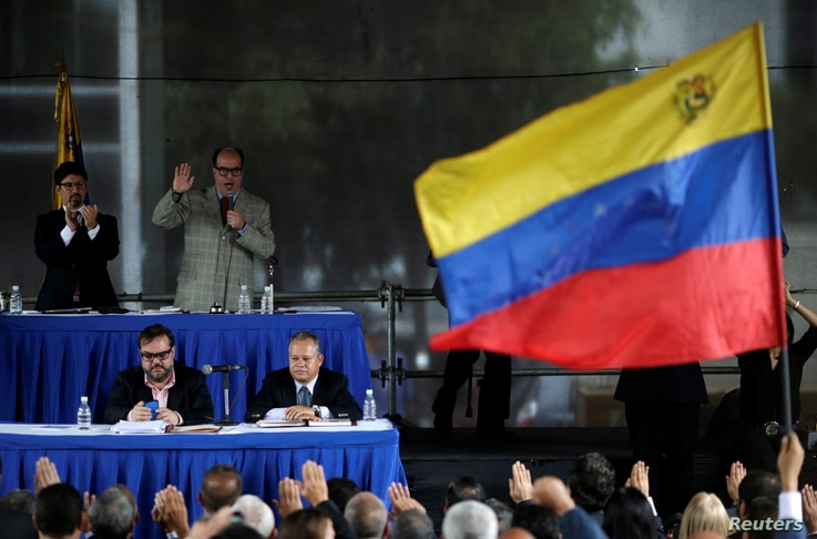 Julio Borges, top right, president of the National Assembly and deputy of the Venezuelan coalition of opposition parties, attends a session of Venezuela's opposition-controlled National Assembly to appoint alternative judges to the Supreme Court in C...