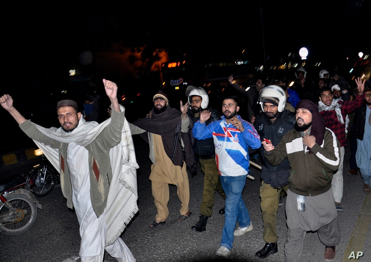 FILE - Pakistani police officers, in helmets, arrest protesters at a demonstration against the acquittal of Asia Bibi, a Pakistani Christian woman who was facing blasphemy charges, in Lahore, Pakistan, Jan. 29, 2019.