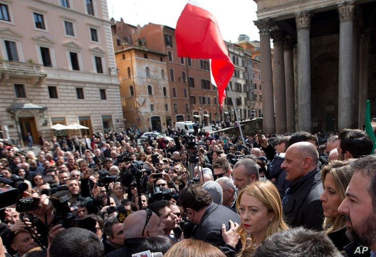 Giorgia Meloni, bottom right, arrives in Rome's Pantheon Square to meet reporters March 16, 2016. The pregnant politician has announced her candidacy for Rome's mayor.