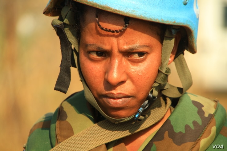 A soldier from United Nations Mission in South Sudan (UNMISS) Ethiopian division patrols the perimeter of protection of civilians (POC) site in Juba, South Sudan, Dec. 5, 2016. (J. Craig/VOA)