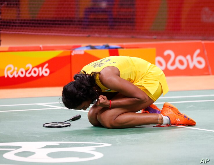 India's Sindhu Pusarla reacts after defeating China's Wang Yihan during the Women's Badminton Singles Quarterfinal at the 2016 Summer Olympics in Rio de Janeiro, Brazil, Aug. 16, 2016.