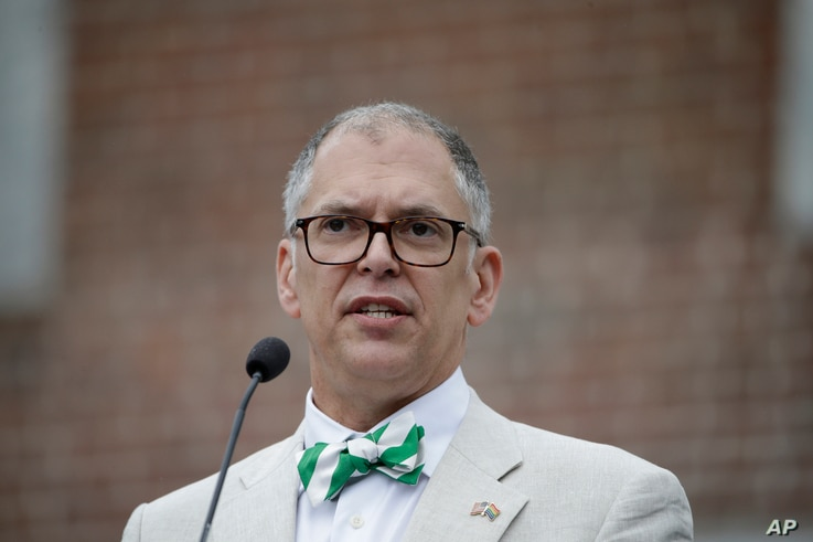 Jim Obergefell, the named plaintiff in the same-sex marriage case decided by the U.S. Supreme Court speaks during the National LGBT 50th Anniversary Ceremony, July 4, 2015, in front of Independence Hall in Philadelphia. The tie he is wearing is part ...
