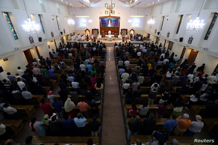 FILE - Worshippers attend their Friday evening Mass at Sacred Heart Catholic Church, as Catholics are awaiting a historic visit by Pope Francis to the United Arab Emirates, in Manama, Bahrain, Jan. 18, 2019.