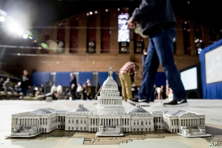 A model of the Capitol is displayed on a giant planning map during a media tour highlighting inaugural preparations being made by the Joint Task Force-National Capital Region for military and civilian planners at the D.C. Armory in Washington, Dec. 1...