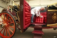 Carriage restorer Dave Evans cleans the 1902 State Landau coach at the Royal Mews in London March 21, 2011.