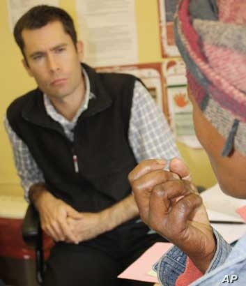 Zithulele Hospital's chief doctor, Ben Gaunt, listens to an HIV-infected patient. He says allied health professionals aren't getting the credit they deserve as South Africa battles HIV and AIDS