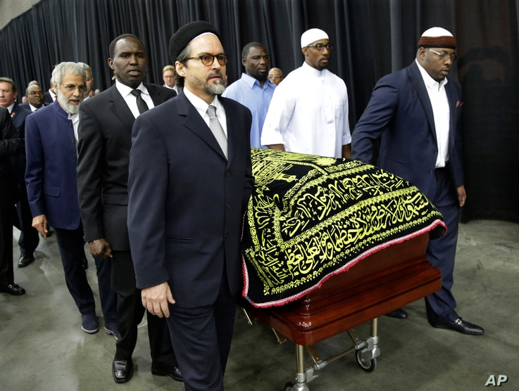 Muhammad Ali's casket is escorted by pallbearers for his Jenazah, a traditional Muslim service, at Freedom Hall in Louisville, Ky., June 9, 2016.