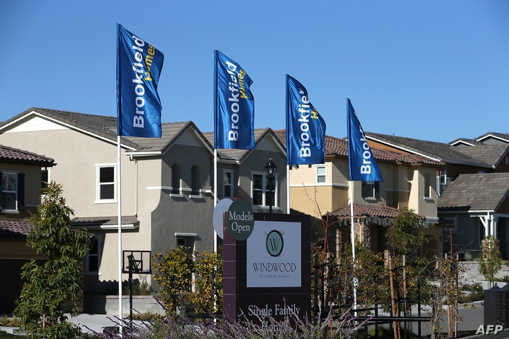 A sign advertising new homes is posted at a housing development in Dublin, California. According to a Commerce Department report, sales of single family homes in the U.S. surged 25.4 percent in October, the larget gain in over 33 years, Dec. 4, 2013.