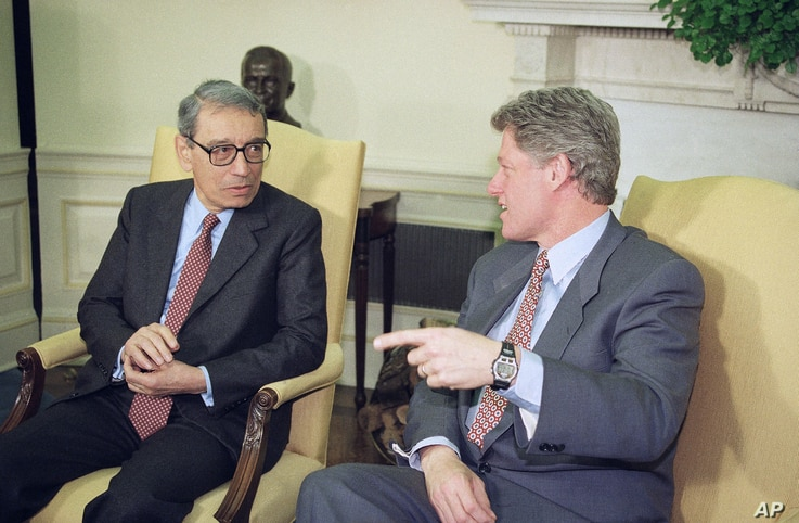 FILE - President Bill Clinton and UN Secretary-General Boutros Boutros-Ghali discuss aerial drops of food rand medicine in eastern Bosnia planned by the U.S., in the Oval Office of the White House in Washington, Feb. 23, 1993.