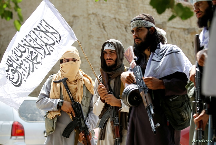 FILE - Members of the Taliban celebrate the cease-fire in Ghanikhel district of Nangarhar province, Afghanistan, June 16, 2018.