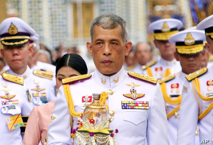 FILE - King Maha Vajiralongkorn, center, during Wesaka Bucha, at Emerald Buddha temple Bangkok, May 29, 2018.