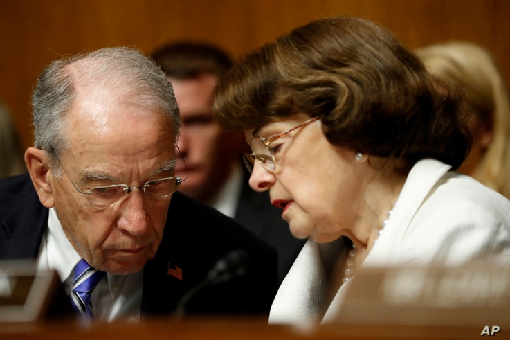 FILE - Senate Judiciary Committee Chairman Sen. Chuck Grassley, R-Iowa, talks with the Committee's ranking member Sen. Dianne Feinstein, D-California, on Capitol Hill in Washington, July 12, 2017.