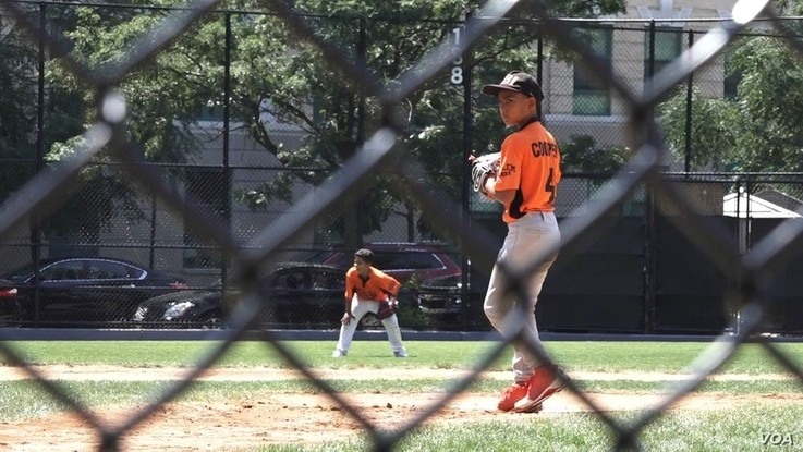Ian Morales, a rising sixth-grader, pitches for the Cooper Pilots at Harlem RBI's Field of Dreams. Cooper beat South Bronx, 7-6, in the 2016 summer championship final, New York, Aug. 12, 2016.