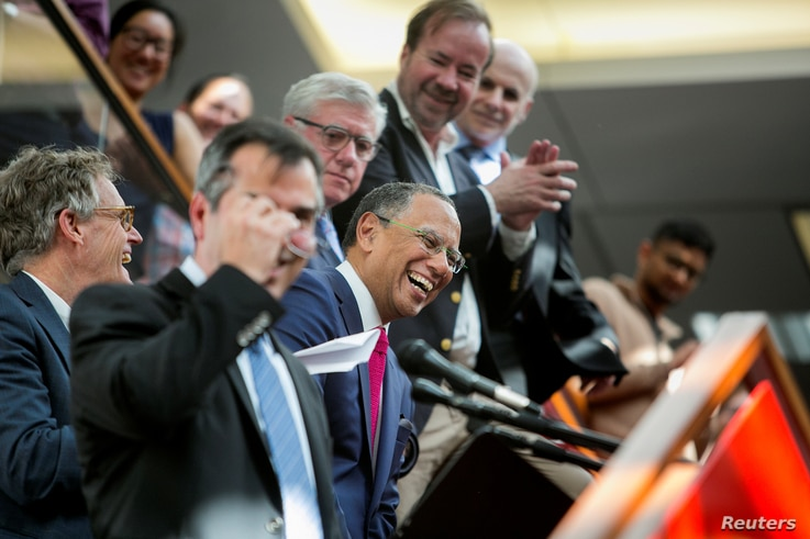Dean Baquet (C), executive editor of The New York Times, celebrates the announcement of the 2017 Pulitzer Prizes in The Times office in New York, April 10, 2017.