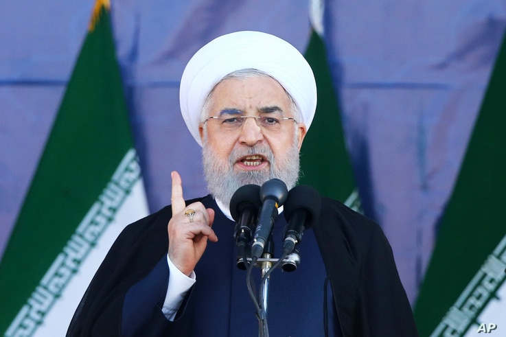 Iran's President Hassan Rouhani speaks at a military parade marking the 38th anniversary of Iraq's 1980 invasion of Iran, in front of the shrine of the late revolutionary founder, Ayatollah Khomeini, outside Tehran, Iran, Saturday, Sept. 22, 2018.