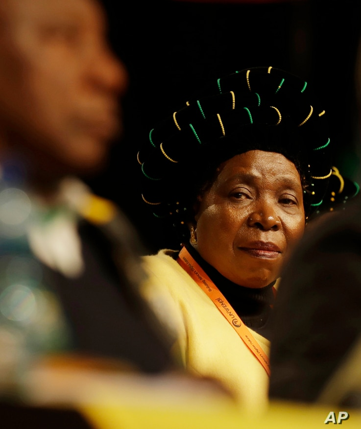 FILE - Former African Union Chairperson, Nkosazana Dlamini-Zuma, looks toward deputy President Cyril Ramaphosa, during their policy conference in Johannesburg, South Africa, July 5, 2017.